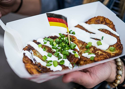 burbach's european pancakes with sour cream and green onions and a flag